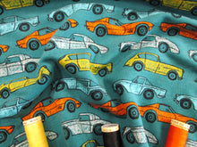 Load image into Gallery viewer, Vintage Cars on a Teal Background Lovely Quality 225 gr/m2  95% Cotton 5% Elastane