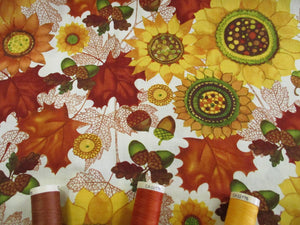 Clothworks Design Autumn Leaves, Sunflowers & Acorns on a Butter Milk Background  100% Cotton