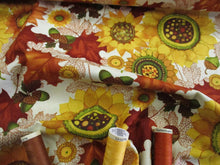 Load image into Gallery viewer, Clothworks Design Autumn Leaves, Sunflowers & Acorns on a Butter Milk Background  100% Cotton