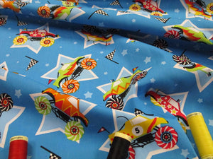 Special Offer! Monster Trucks, Stars and Racing Flags Bright Colors on a Blue Background 100% Cotton