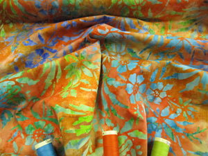 Batik Printed Cotton Flower Heads & Leaves Lime, Royal Blue & Turquoise on a Orange Background 100% Cotton