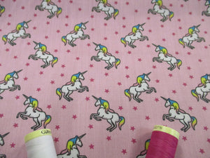 Unicorns & Stars on a Candy Pink Background Poly Cotton