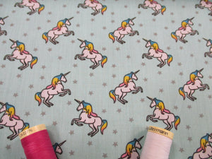 Unicorns & Stars on a Mint Background Poly Cotton
