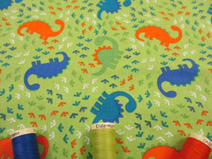 Dinosaurs Assorted Orange Green & Turquoise on a Lime Green Background 100% Cotton
