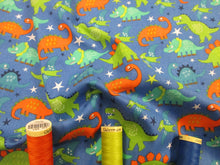 Load image into Gallery viewer, Dinosaurs Assorted Orange Green & Turquoise on a Bight Blue Background 100% Cotton