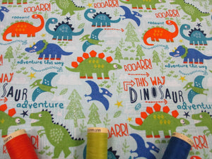 Dinosaur Adventure on a Pale Blue Background 100% Cotton
