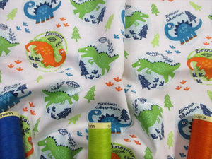 Dinosaurs in Circles Orange Green & Turquoise on a White Background 100% Cotton