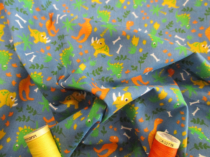 Cute Little Dinosaurs on a Petrol Blue Background Poly Cotton