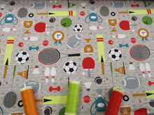 Load image into Gallery viewer, Sports Day Footballs, Tennis Rackets, Trophies etc on a Beige Background 100% Cotton