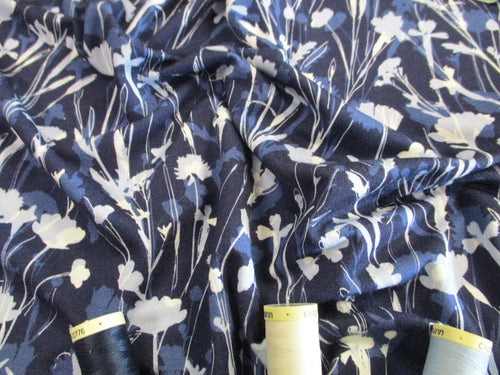 Jersey Floral Design Blue & Ivory on a Navy Background 96% Viscose 4% Lycra