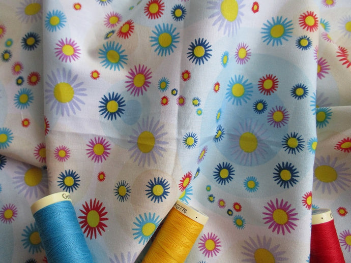 Bright Multi Color Flower Heads & Blue Circles on a White Background 100% Cotton