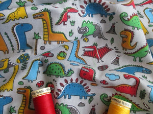 Bright Color Dinosaurs on a Silver Grey Background Poly Cotton