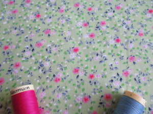 Ditsy Flowers Pink & Blue on a Lime Background Poly Cotton