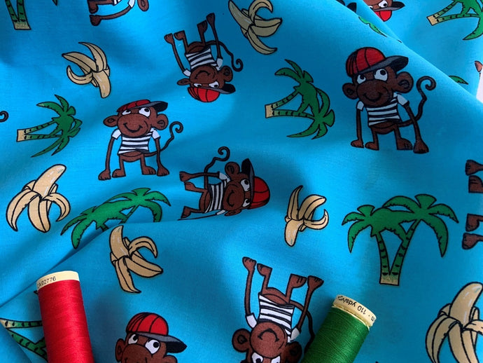 Cheeky Monkeys on a Turquoise Background 100% Cotton
