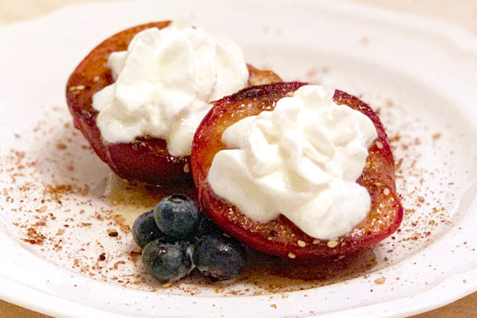 Grilled Peaches with Dukkah, Drizzled Honey, and Blueberries