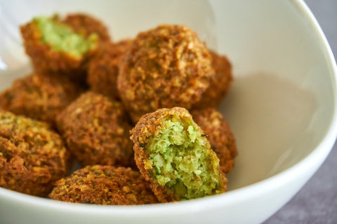 Image of freshly made falafel in a white bowl