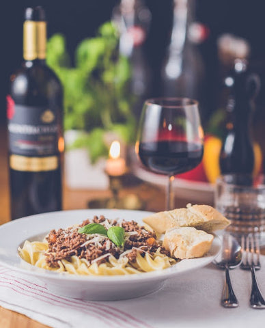 Spaghetti bolognese with a red wine