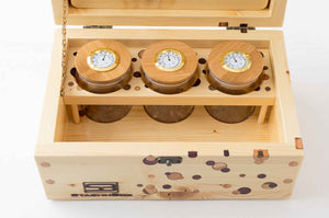 Pine StashhBox 2.0 with exotic hardwood dot inlays and StashhJars in rack