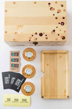 Load image into Gallery viewer, Overview of Pine StashhBox Daily Toker 2.0 with included StashhJars, magnetic wood rolling tray, Boveda packs, rolling tips, and stickers