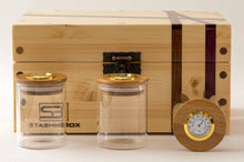 Load image into Gallery viewer, Front view of Pine StashhBox 2.0 with exotic hardwood inlays and StashhJars on display
