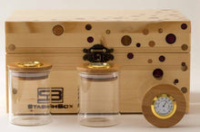 Load image into Gallery viewer, Front view of pine StashhBox 2.0 with exotic wood inlays and StashhJars on display