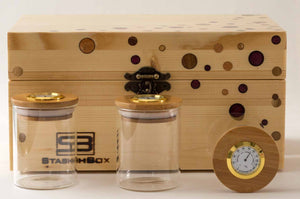 Front view of pine StashhBox 2.0 with exotic wood inlays and StashhJars on display