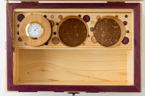Inside  pine StashhBox Daily Toker 2.0 with exotic wood inlays and StashhJar in rack