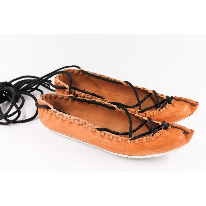 Women's handmade leather moccasins; flexible, comfortable and made of 100% natural leather to imitate a barefoot walking feel.