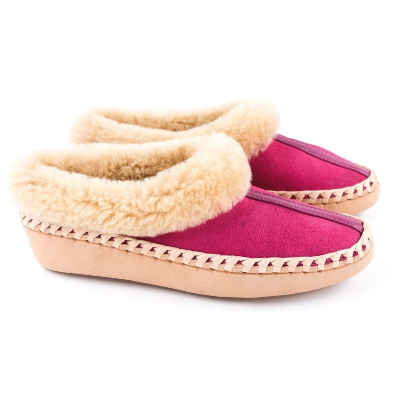 Pink sheepskin slippers with leather accent stripe, handmade using 100% premium quality European sheepskin and leather.