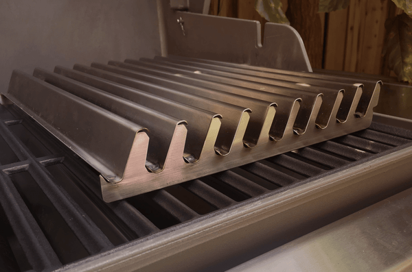 A True Wave Grilling surface on top of a grill