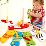 Baby Playing with Wood Fish Game