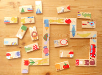 Wood Dominoes painted with animal and plant pictures.
