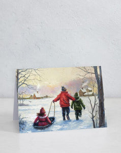 Boxed Assortment of 15 cards: Three Children Sledding by Vickie Wade