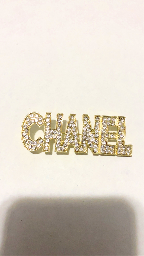 Gold Word brooch