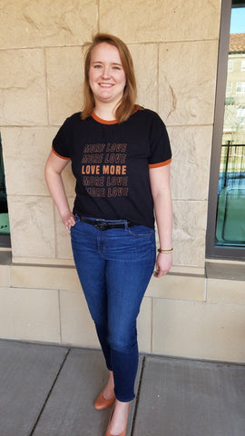 "Christine wearing ""Love More"" shirt"