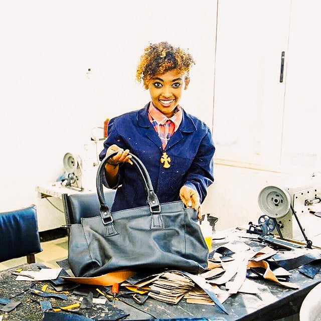 woman smiling in leather workshop in Ethiopia
