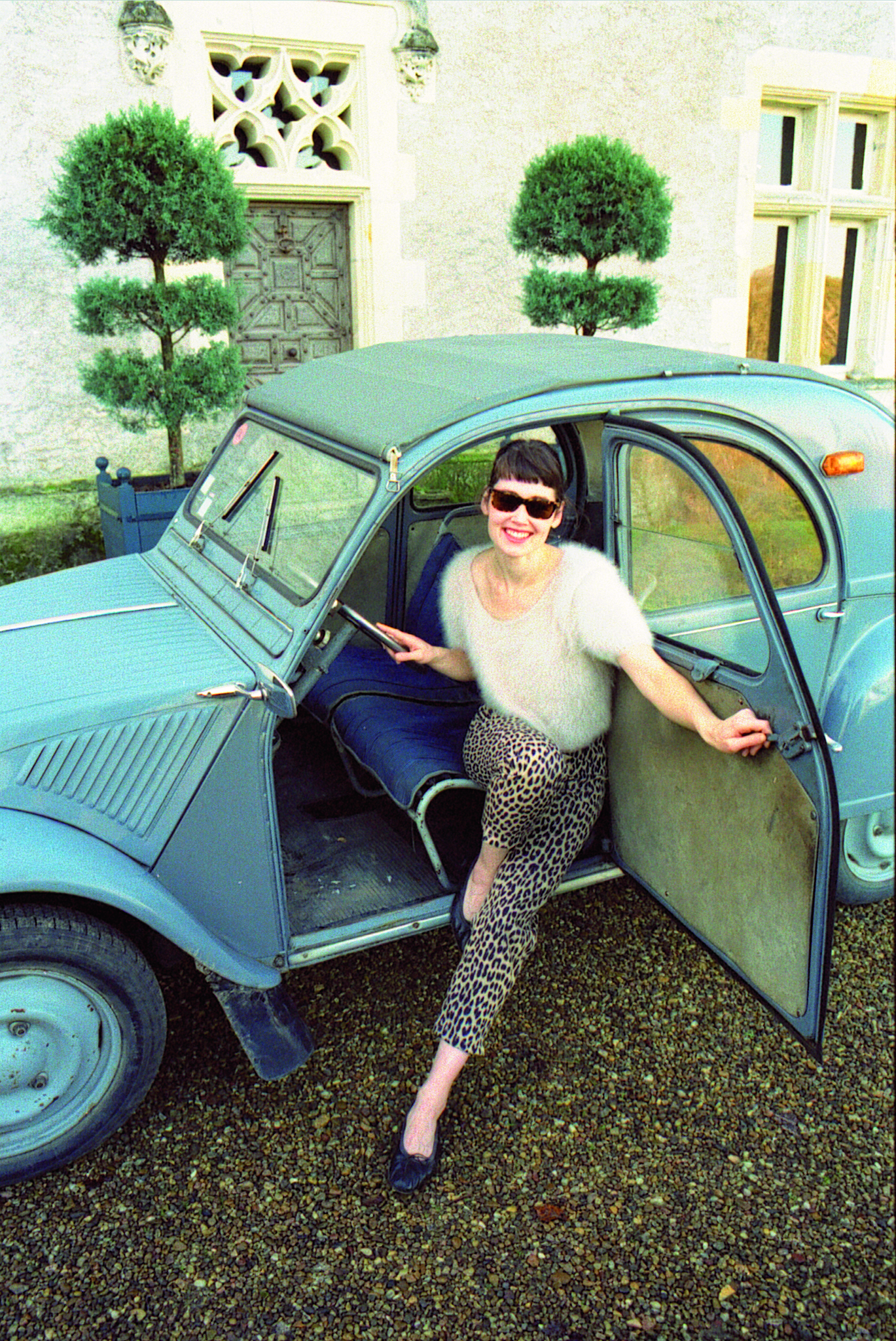 Rachel Riley archive image posing with a car