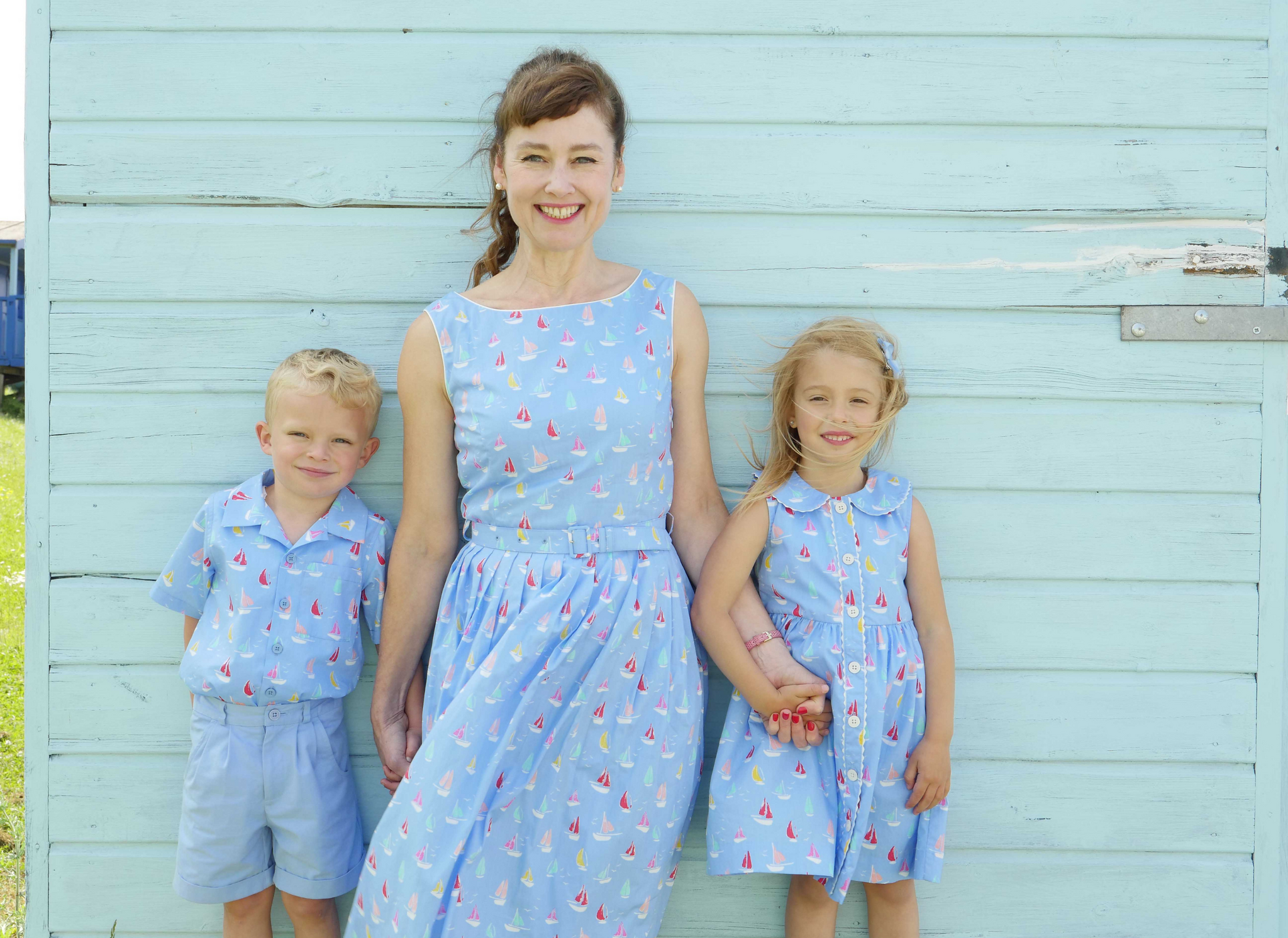 Rachel Riley wearing matching outfits with two children