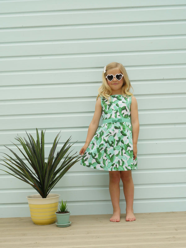 cactus pleated dress, summer dress, girl dress, Rachel Riley dress, green, ivory, party, holiday, occasion wear