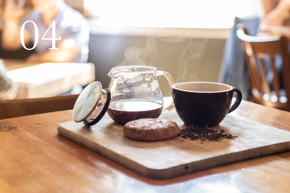 Aldea Coffee UNITEA one touch teapot on a tray with a cookie and cup