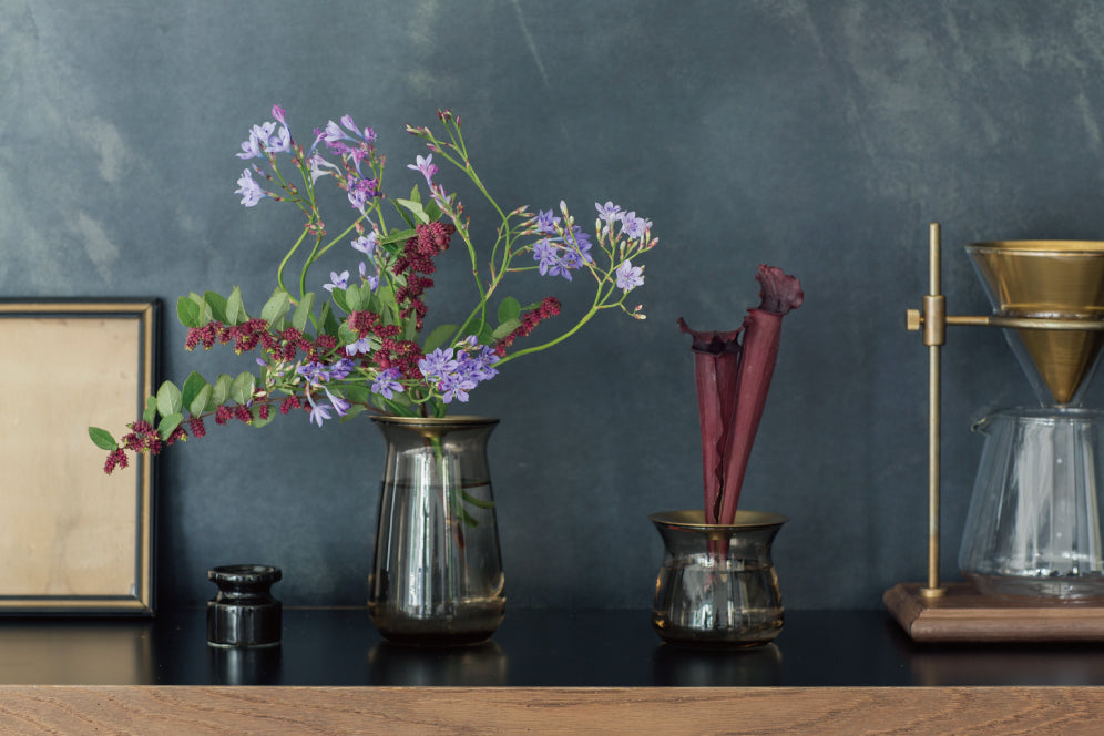 Assortment of flowers in LUNA vases next to a coffee brewer