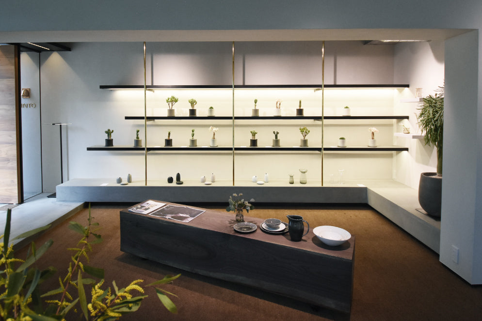 Display shelves with assortment of KINTO products