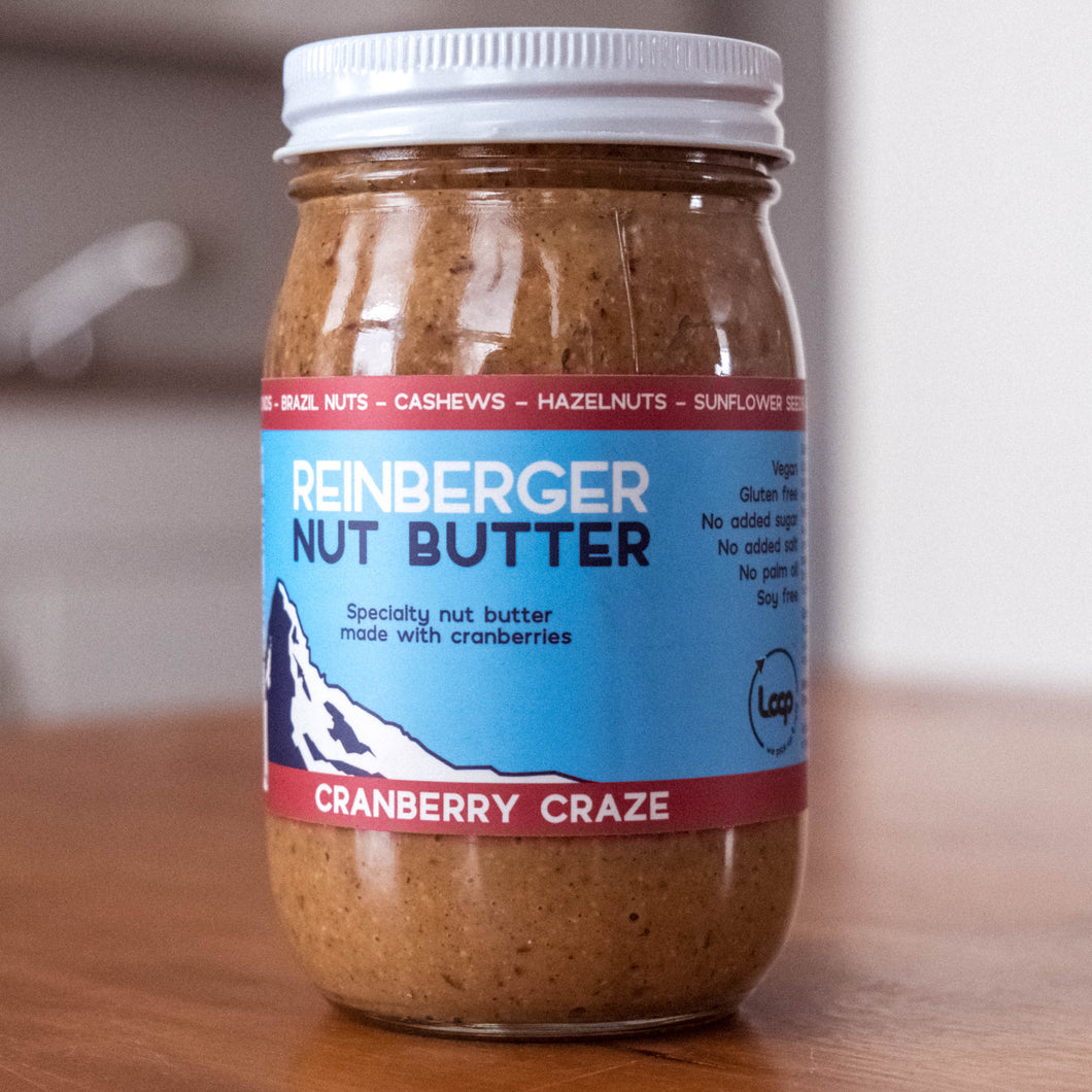 A jar of Reinberger Nut Butter all-natural cranberry nut butter.
