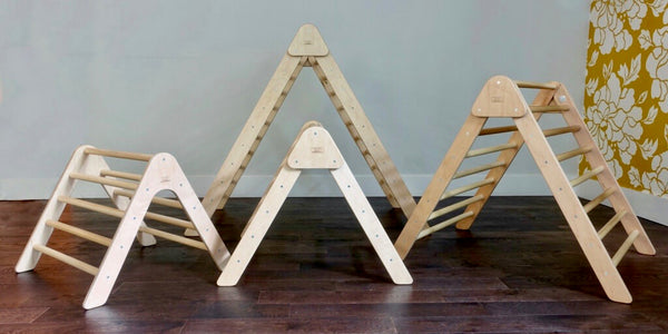 our whole family of pikler triangles. the montessori climber