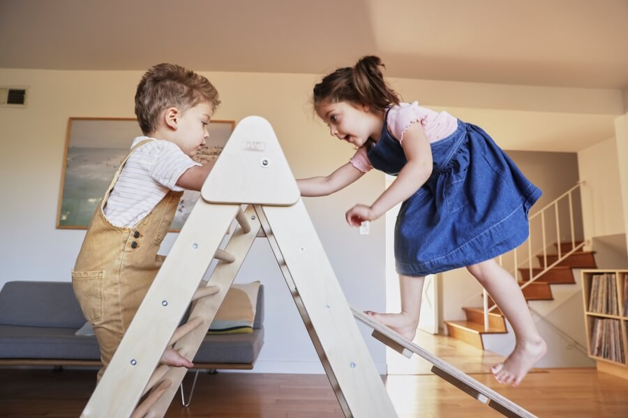 two kids climbing on best jumbo pikler triangle