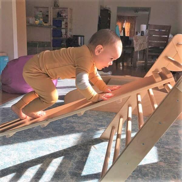 baby climbing pikler triangle