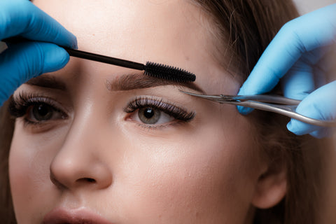 Woman getting her eyebrows trimmed