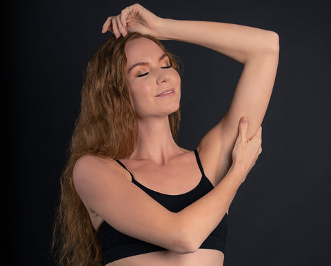 woman posing with arms up