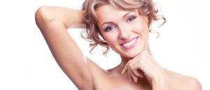 A smiling woman with smooth underarms