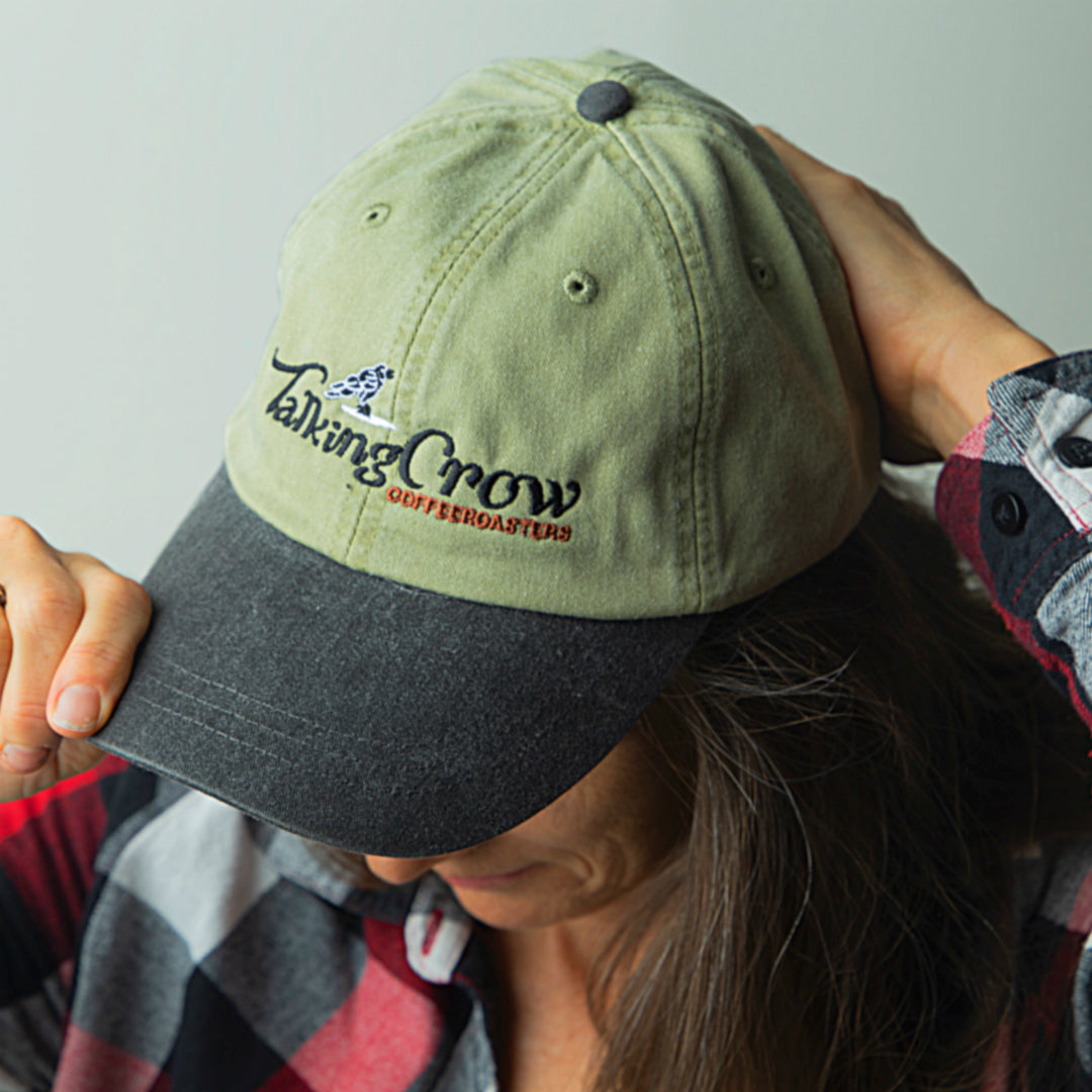 image of girl wearing talking crow ball cap